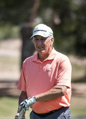 Bob Kennedy follows his putt.