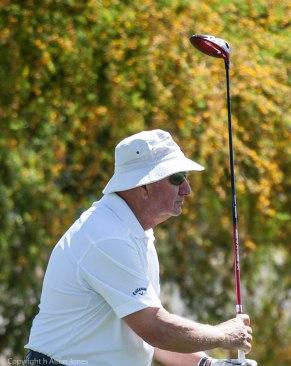 Rudi Barich follows his tee shot.