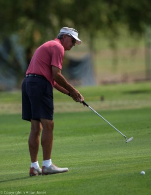 Dick Reid with a long putt.