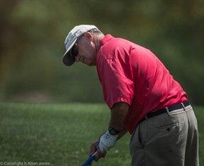 Jeff Clark strikes his putt.
