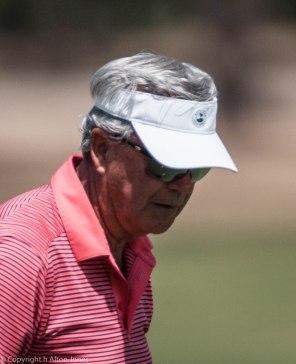 Dick Reid follows his putt.