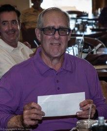 Frank Bogacz holds the prize.
